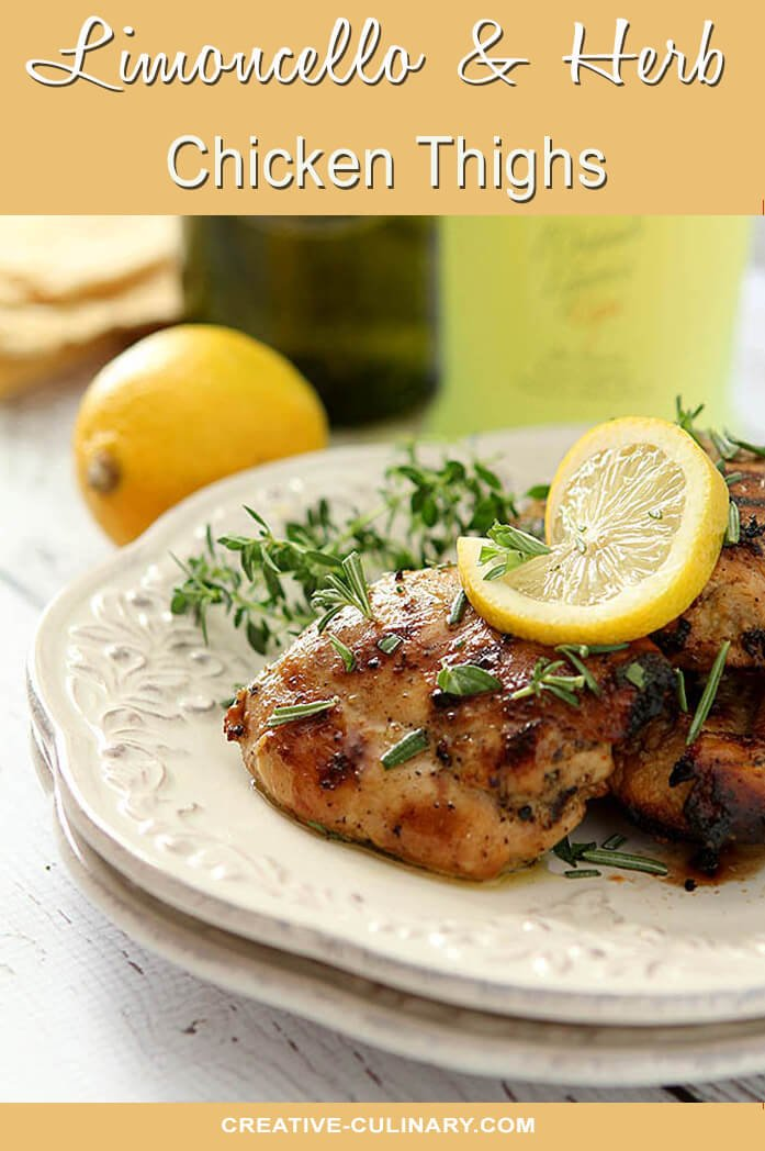 Barbecued Limoncello Chicken Thighs with Fresh Herbs Served on White Plates with Lemon and Thyme Garnish