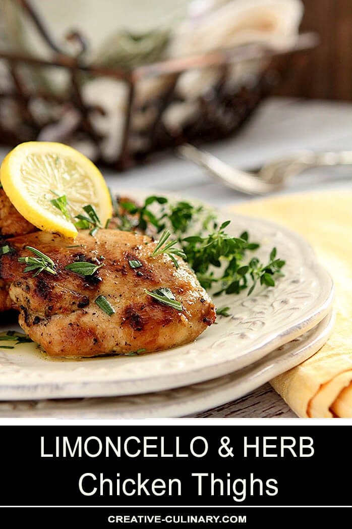 Barbecued Limoncello Chicken Thighs with Lemon and Herb Garnish