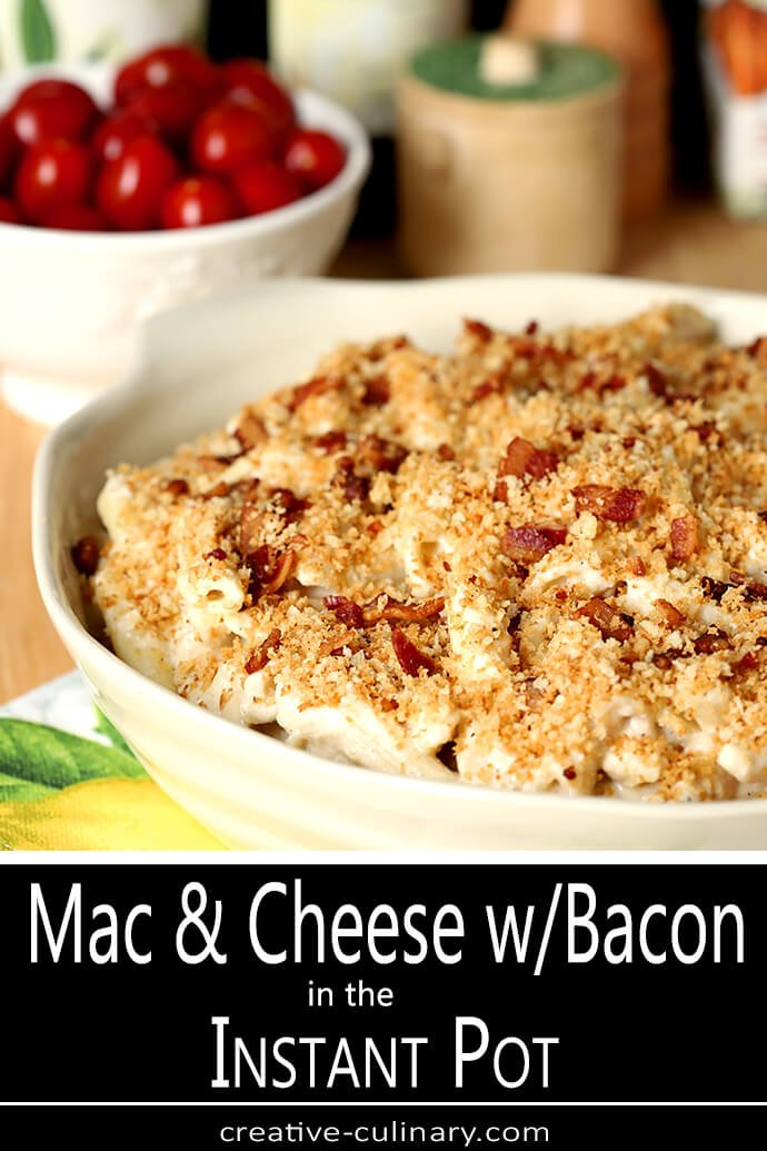 Casserole of Macaroni and Cheese with Bacon in an Off White Earthenware Casserole Dish