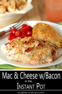 White Plate with Macaroni and Cheese with Bacon Served with Chicken Thigh and Sliced Fresh Tomatoes