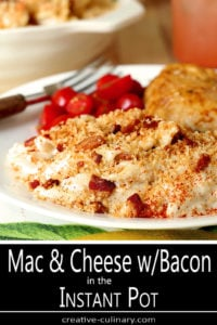 Closeup of Macaroni and Cheese with Bacon on Plate with Chicken and Sliced Tomatoes