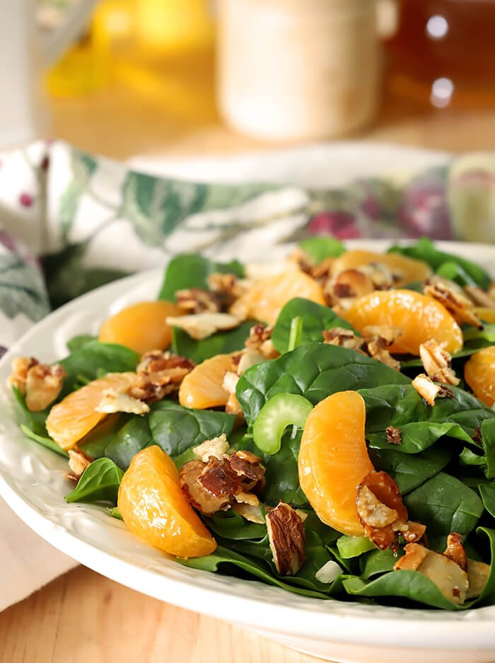 Mandarin Orange Salad with Candied Almonds Served on White Plate