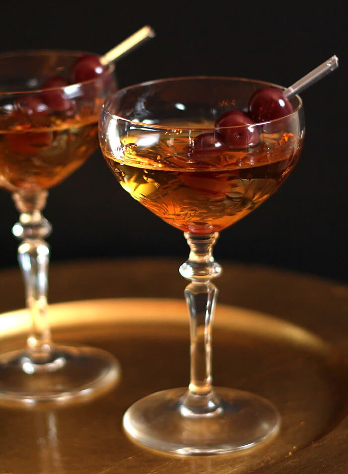 Classic Manhattan Cocktails Served on a Gold Bar Tray