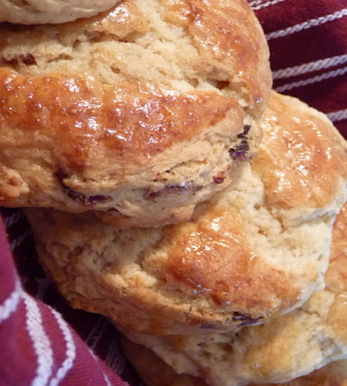 Maple Bacon Biscuits from the Huckleberry Cafe, Nestled on a Burgundy and White Kitchen Towel