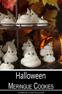 Halloween Meringue Ghost Cookies with Chocolate Chips Eyes on a Cookie Stand
