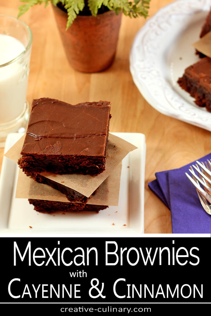 Mexican Brownies with Cinnamon and Cayenne Pepper Stacked on a White Square Plate