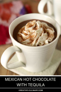 Mexican Hot Chocolate with Tequila Served in a White Mug with Whipped Cream on Top