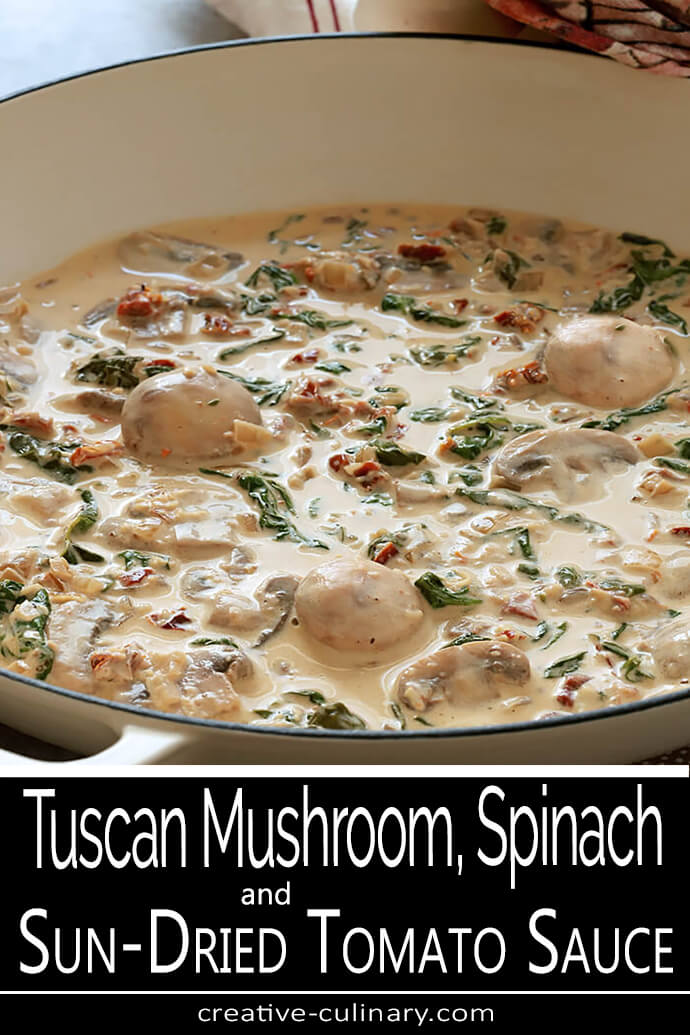 Creamy Mushroom Sauce with Sun-Dried Tomatoes and Spinach in a White Skillet for PIN