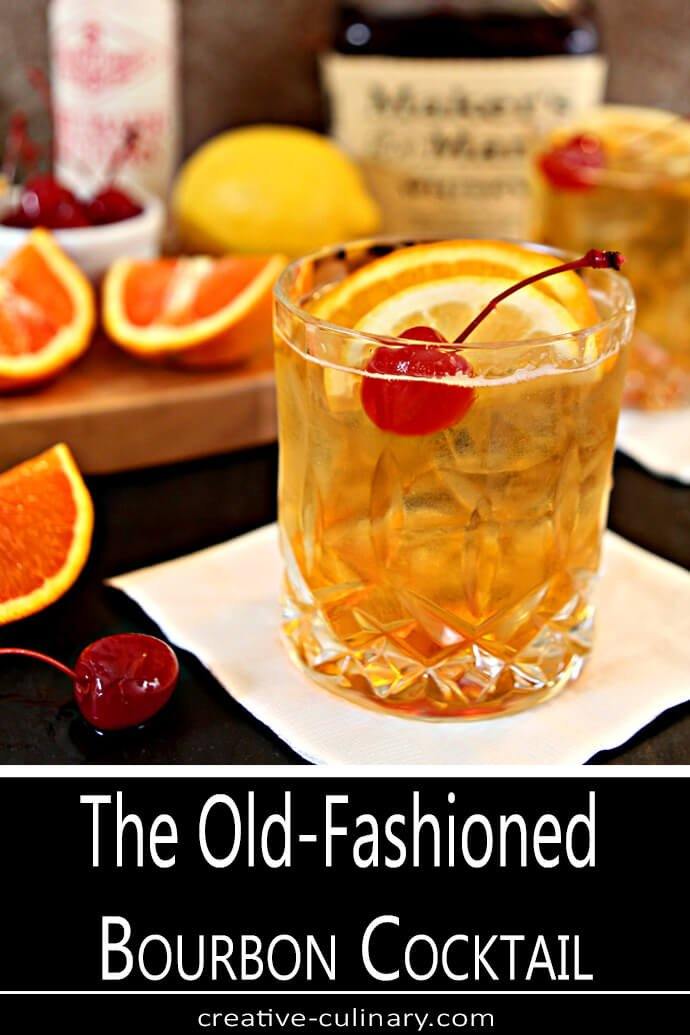 The Old  Fashioned Cocktail Garnished with Lemon, Orange, and a Maraschino Cherry