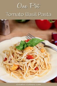 One Pot Tomato Basil Pasta Served on a White Plate and Garnished with a Basil Leaf