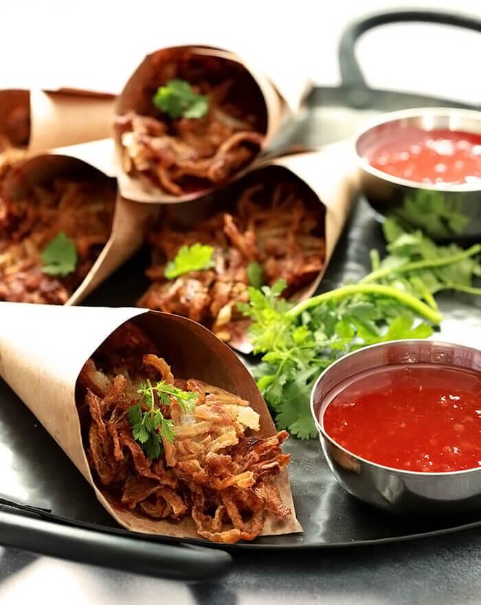 Onion Pakoras - Indian Onion Fritters accompanied by a Sweet Chili Sauce