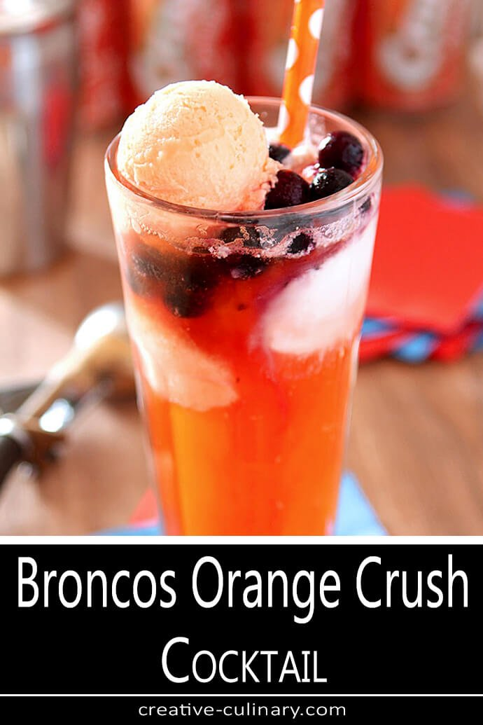 Broncos Orange Crush Cocktail Served in a Tall Ice Cream Soda Glass with Blueberries