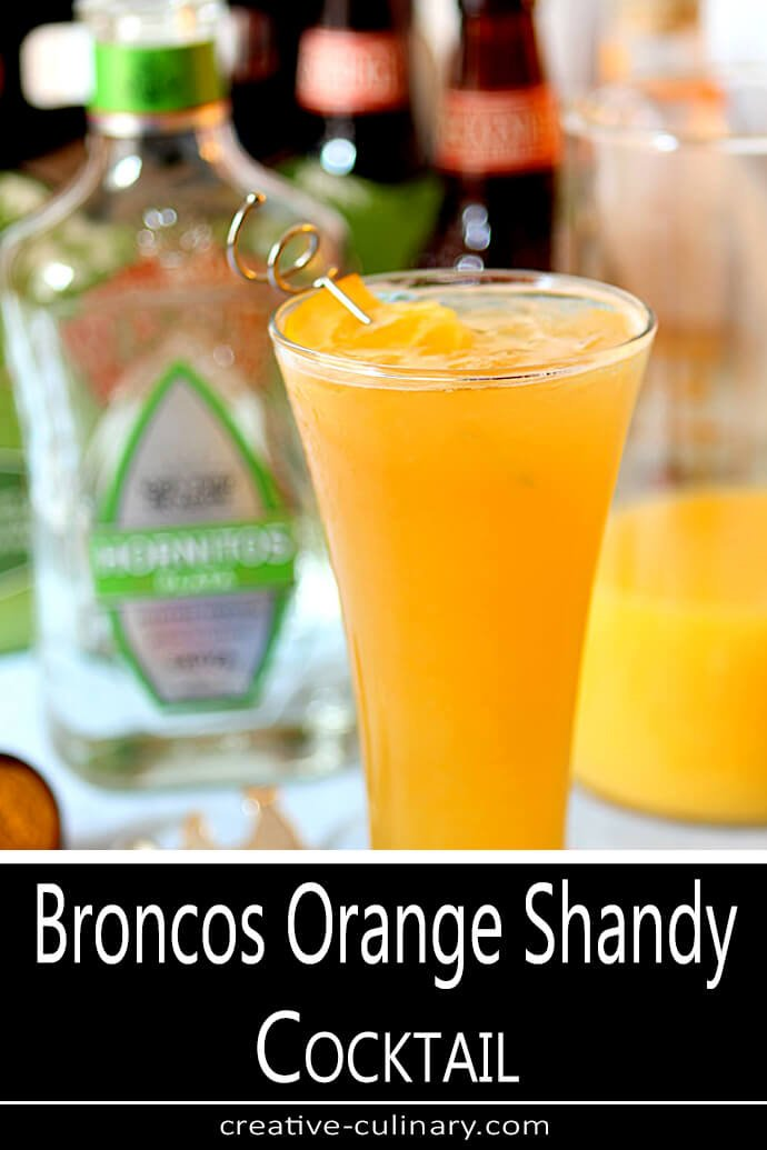 Orange Shandy Cocktail Served in a Tall Glass and Garnished with an Orange Slice