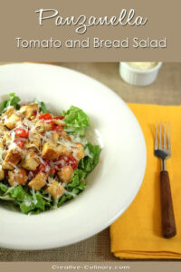 Panzanella - Bread and Tomato Salad in White Bowl on Yellow Placemat