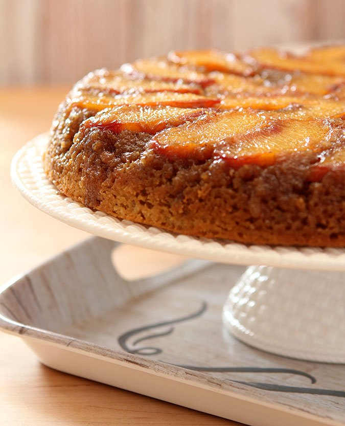 Fresh Peach Upside Down Cake on a White Cake Stand
