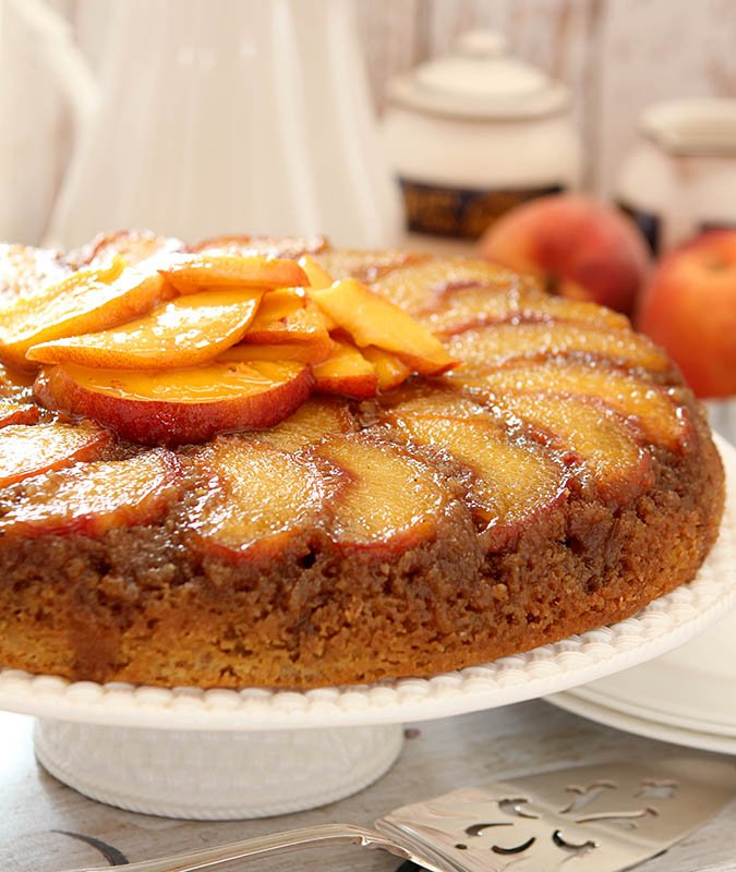 Fresh Peach Upside Down Cake Garnished with Peach Slices