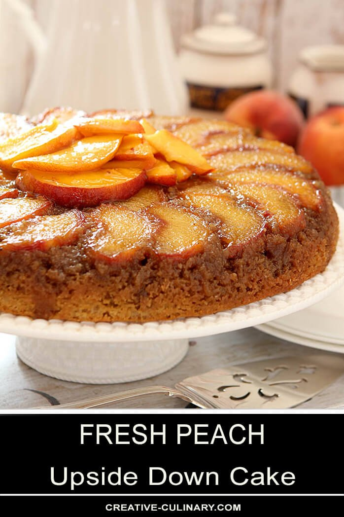 Peach Upside Down Cake on Cake Plate with Sliced Peaches on Top