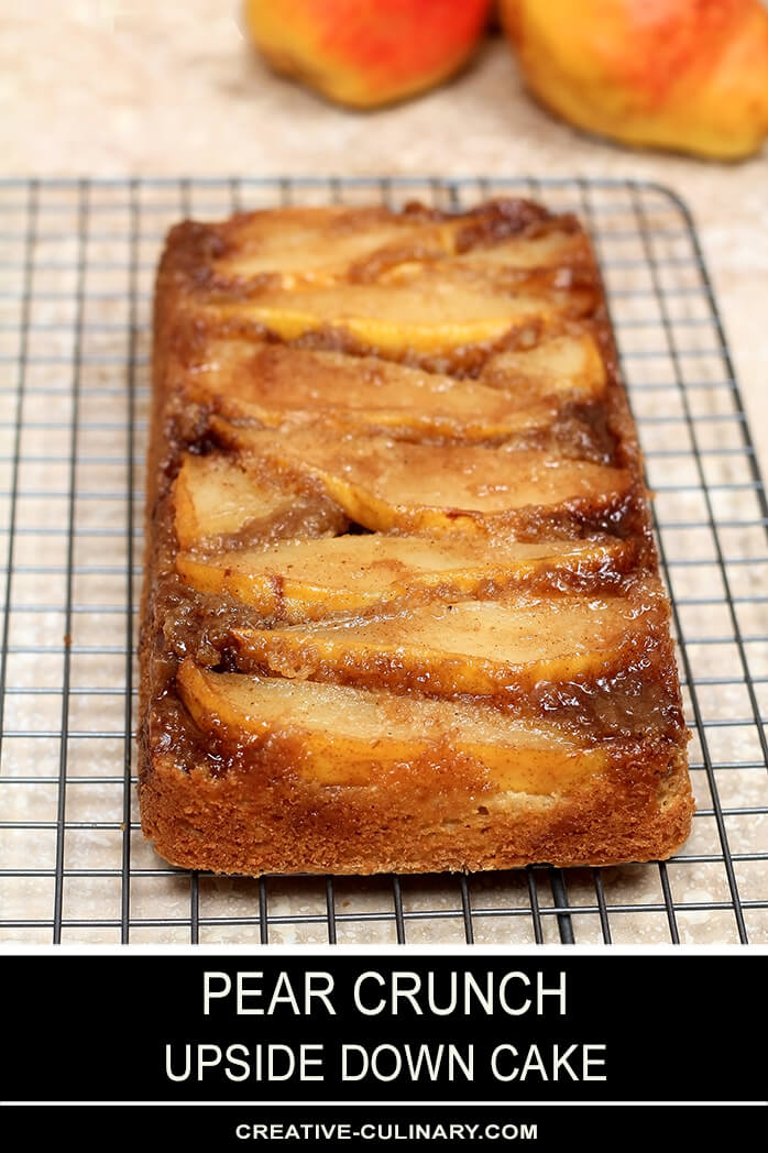 Upside Down Pear Crunch Coffee Cake on a Wire Cooling Rack