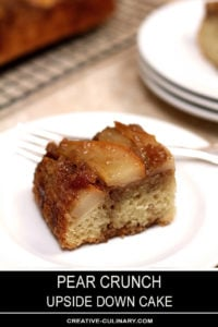 Closeup of Piece of Upside Down Pear Crunch Coffee Cake on a White Plate