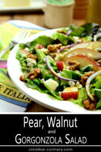 Salad with Greens, Pear, Walnuts, and Gorgonzola Cheese in White Salad Bowl