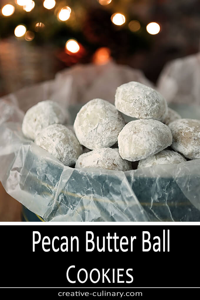 Pecan Butter Ball Cookies in a Holiday Tin in a Green Holiday Tin