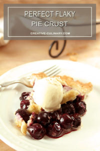 Perfect Flaky Pie Crust on Cherry Pie Slice with Scoop of Ice Cream