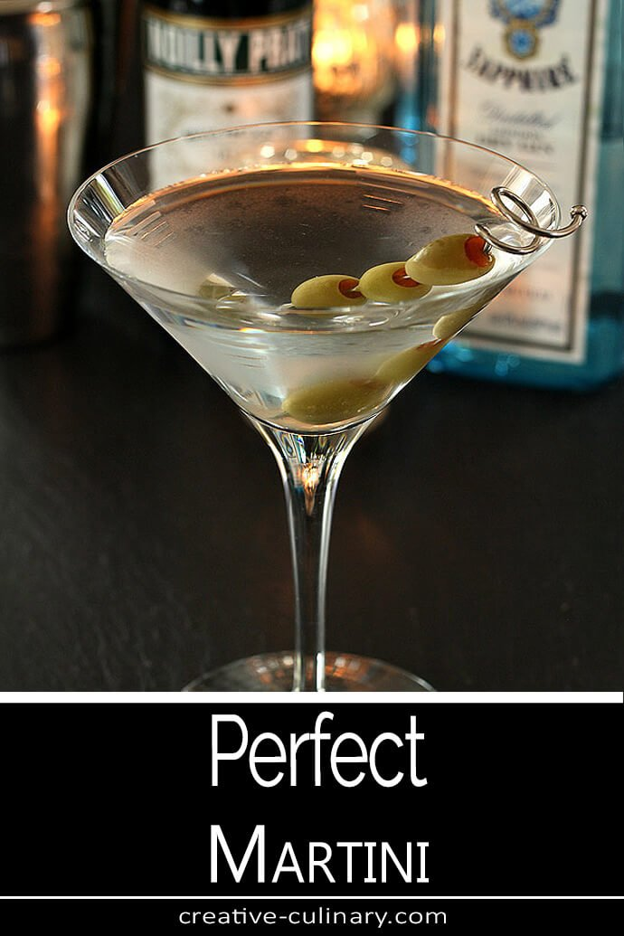 The Perfect Martini Served with Green Olives in a Martini Glass