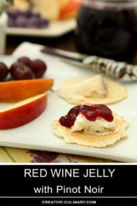 Red Wine Jelly Served on a Cracker on Top of Mascarpone Cheese