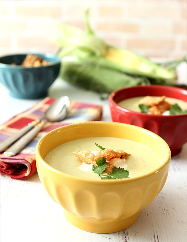 Roasted Poblano Pepper and Corn Soup Served in a Yellow Ceramic Bowl