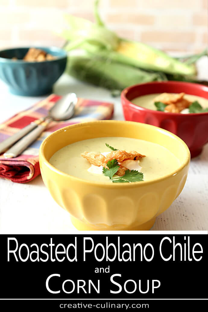 Roasted Poblano Chile and Corn Soup in a Yellow Ceramic Bowl with Fried Tortilla Strips