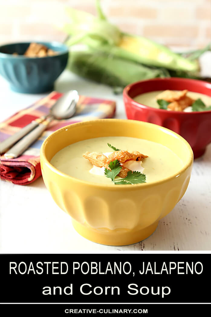 Roasted Poblano Pepper and Corn Soup in Yellow Bowl Garnished with Tortilla Strips