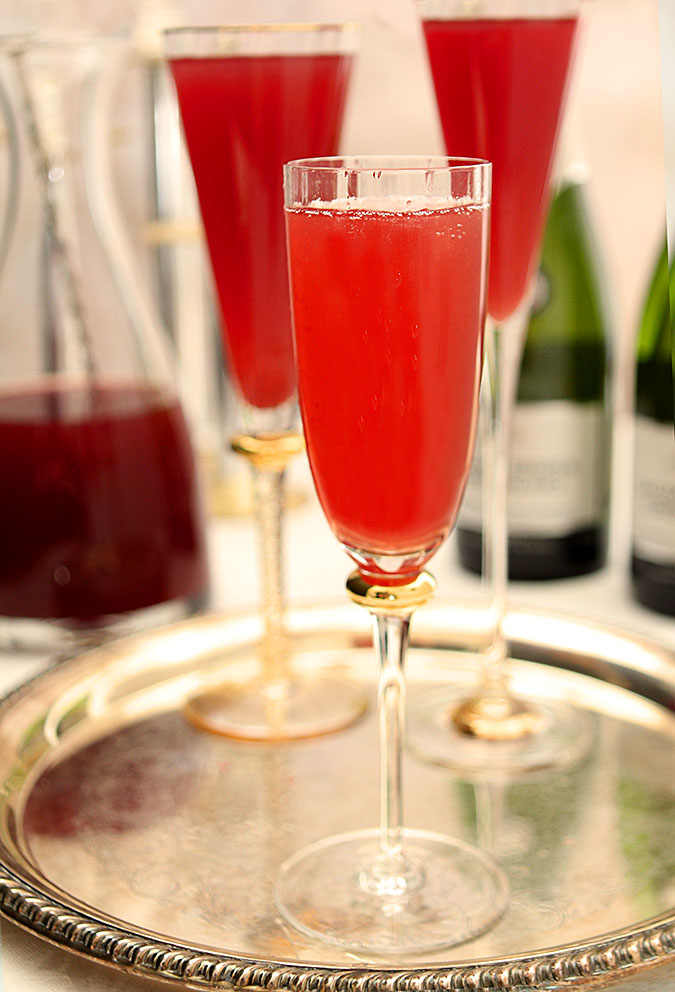 Pomegranate and Blood Orange Mimosa Cocktail Served on a Tray