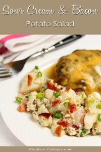 Potato Salad with Bacon and Sour Cream on Plate with Cheeseburger