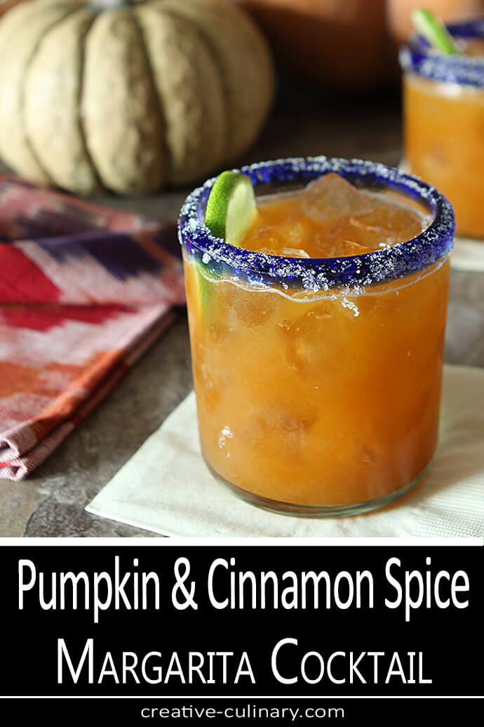 Pumpkin and Cinnamon Spiced Margarita Cocktail in a Lowball Glass with a Blue Rim