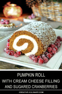 Whole Pumpkin Roll with Cream Cheese Filling Garnished with Sugared Cranberries