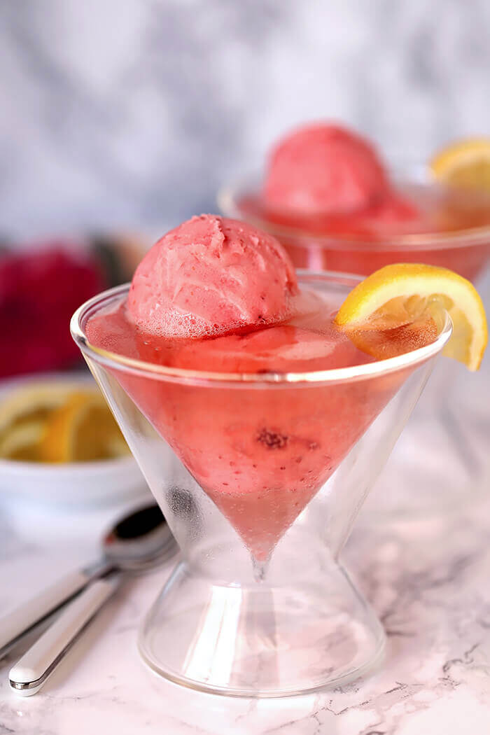 Raspberry Lemonade Wine with Sherbet Served in a Martini Glass and Garnished with Lemon and Served in a Martini Glass