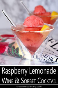 Raspberry Lemonade Wine with Strawberry Sherbet Served in a Martini Glass and Garnished with Lemon