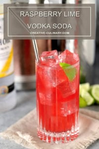 Raspberry Lime Vodka Soda Garnished with Lime Wedge