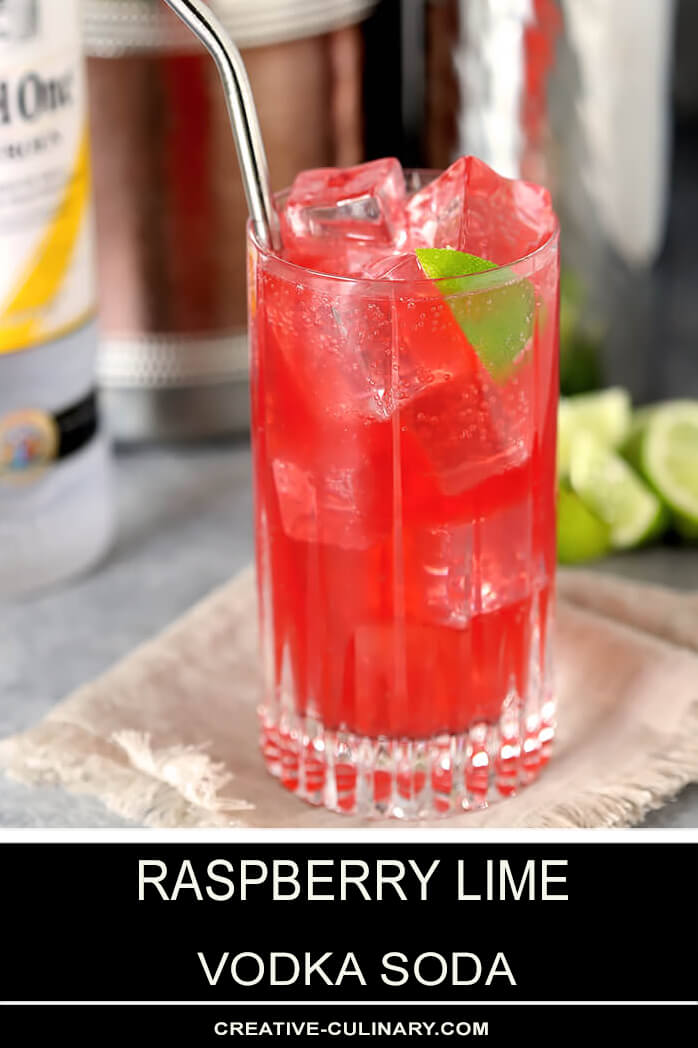 Raspberry Lime Vodka with Straw and Lime Wedge