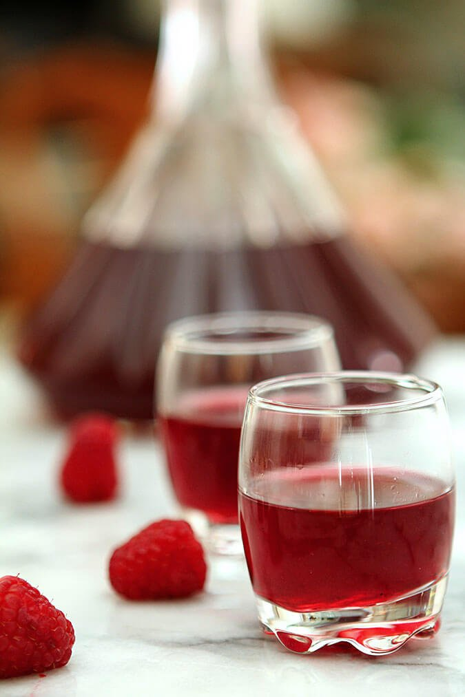 Homemade Raspberry Liqueur Served in small apertif glasses.