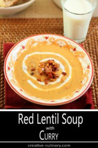 Red Lentil Soup with Ham and Curry Served in a Red and Tan Print Bowl