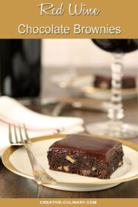 Red Wine Brownies with Toasted Walnuts on Small White Plate with Gold Trim and Glass of Cabernet Wine