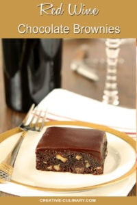 Red Wine Brownies with Toasted Walnuts on Small White Plate with Gold Trim