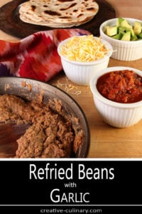 Skillet of Refried Beans with Garlic and Bowls of Condiments