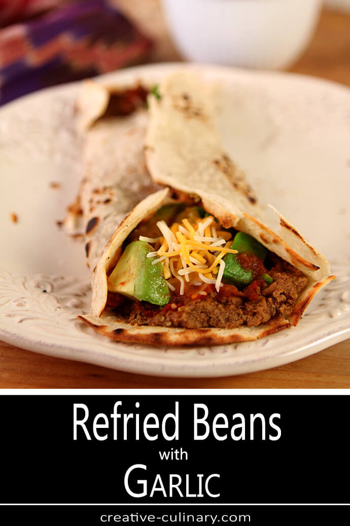 Refried Beans with Garlic in a Tortilla Wrap with Salsa, Avocado, and Cheese