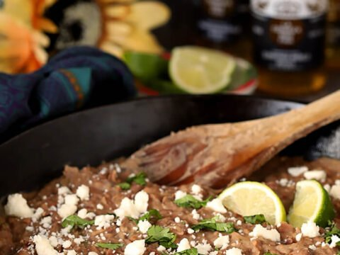 Cast Iron Skillet with The Best Re-Fried Beans with Bacon