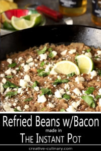 Closeup of The Best Re-Fried Beans with Bacon in a Cost Iron Skillet