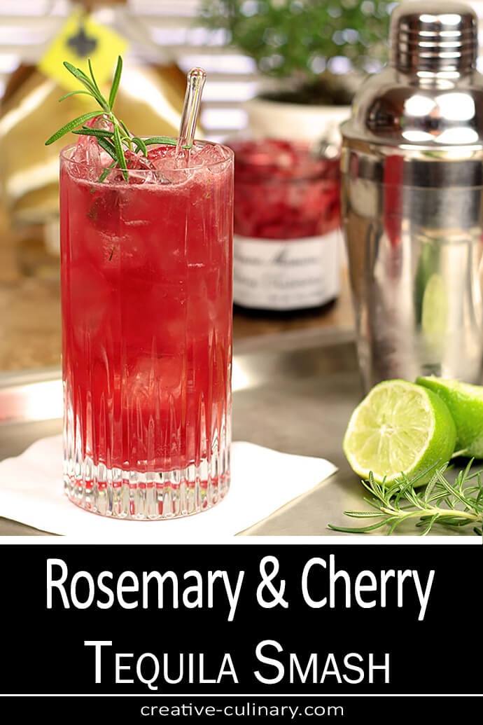 Rosemary and Cherry Tequila Smash in a Tall Glass Garnished with Rosemary and Lime