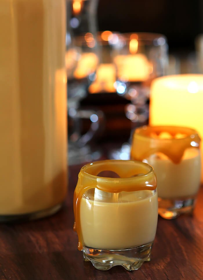 Salted Caramel Cream Liqueur in Liqueur Glasses with a Caramel Rim