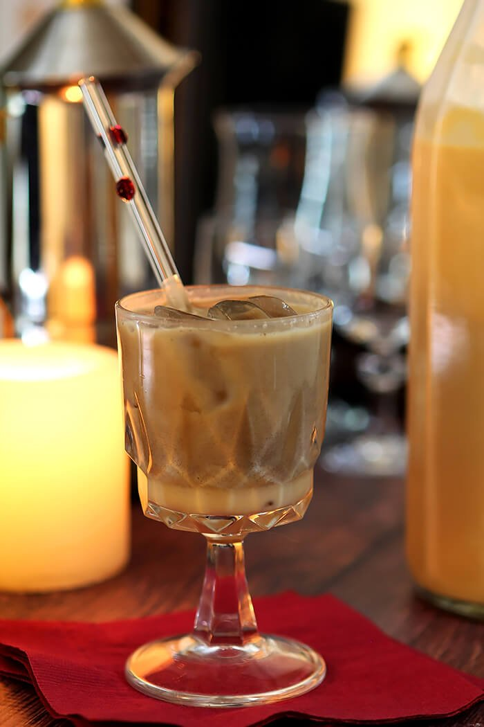 Salted Caramel Cream Liqueur in Liqueur Glasses with Espresso in a Cocktail Glass
